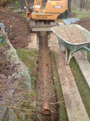 trench being backfilled