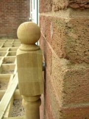 fix newel post to wall